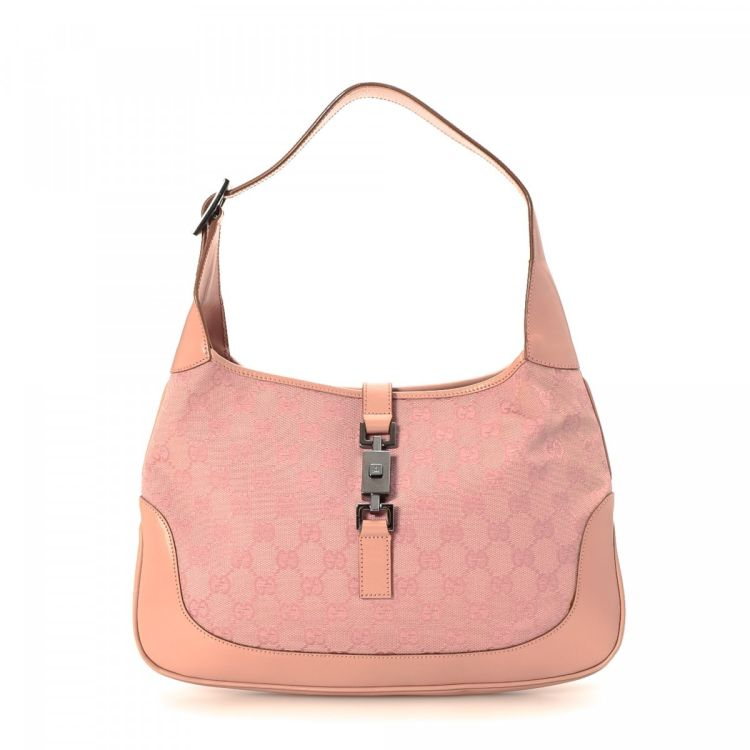 ed146e4c0c914d LXRandCo guarantees the authenticity of this vintage Gucci Jackie shoulder  bag. This sophisticated purse was crafted in gg canvas in beautiful light  pink.