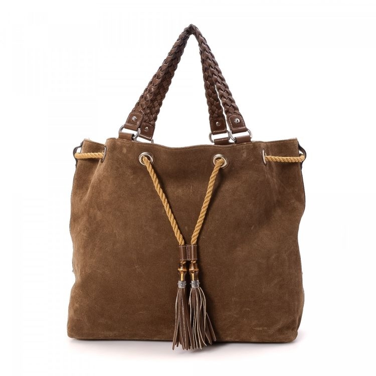 1b740f713f8 LXRandCo guarantees this is an authentic vintage Gucci tote. This beautiful tote  bag in brown is made in bamboo suede. Due to the vintage nature of this ...