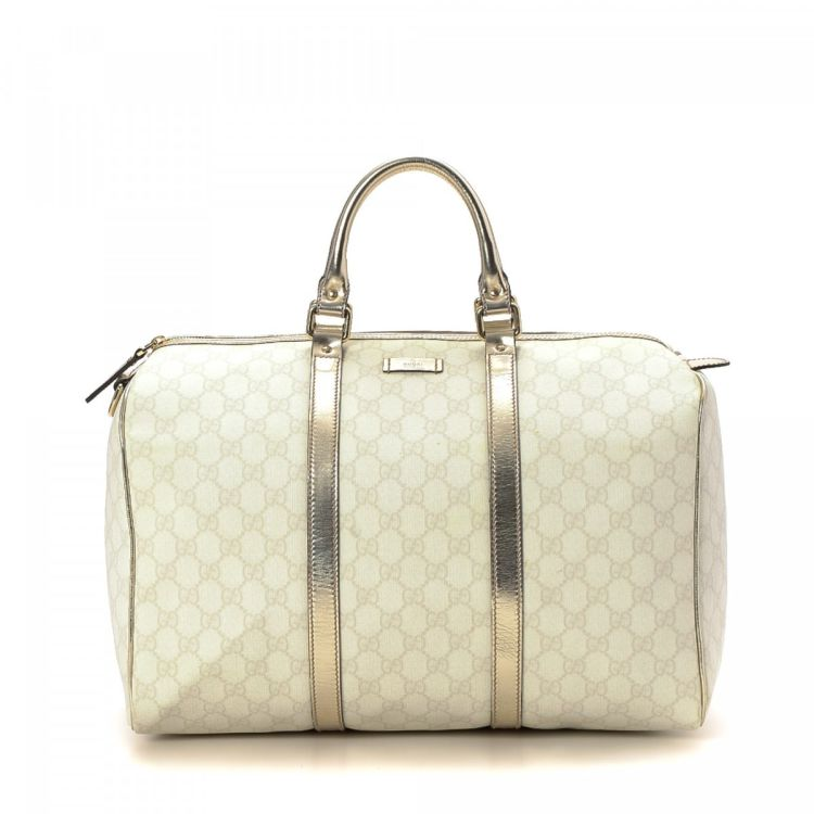 4c3caa3b27bf96 The authenticity of this vintage Gucci Boston Bag travel bag is guaranteed  by LXRandCo. This sophisticated weekend bag was crafted in gg supreme  coated ...