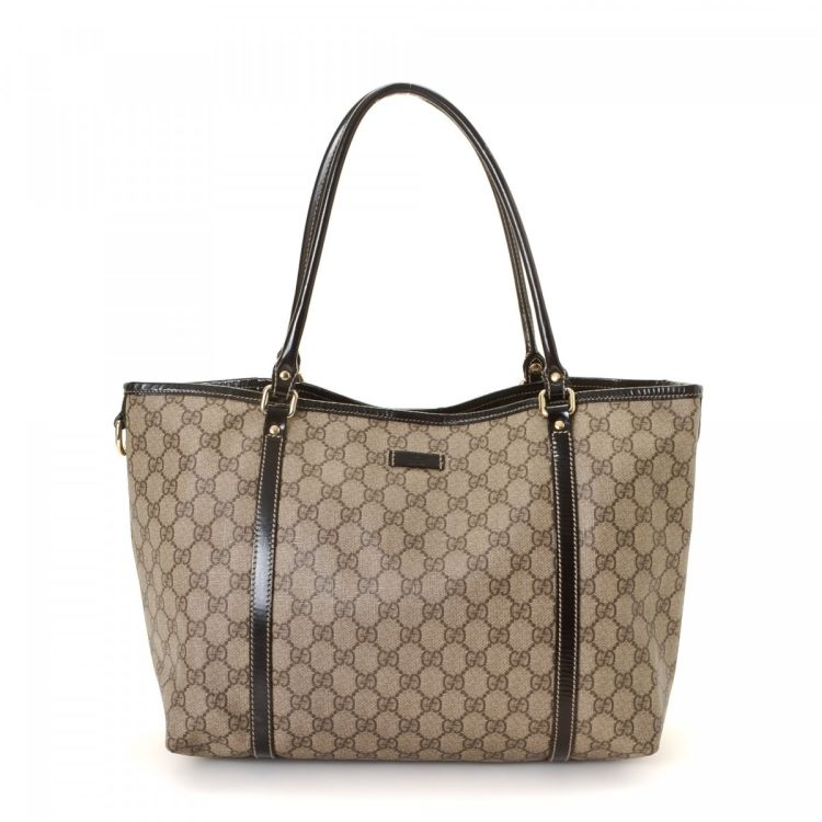 d85ecbd08 LXRandCo guarantees this is an authentic vintage Gucci Joy Supreme tote.  Crafted in gg canvas, this classic bag comes in beige. Due to the vintage  nature of ...