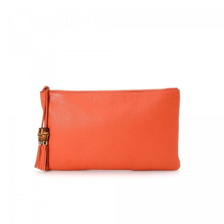 8bb05a65fe5a The authenticity of this vintage Gucci Tassel Bag clutch is guaranteed by  LXRandCo. This luxurious wristlet in beautiful orange is made in bamboo  leather.