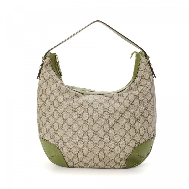 5b2d896236fa The authenticity of this vintage Gucci Hobo Bag handbag is guaranteed by  LXRandCo. This beautiful handbag in beige is made in gg supreme coated  canvas.