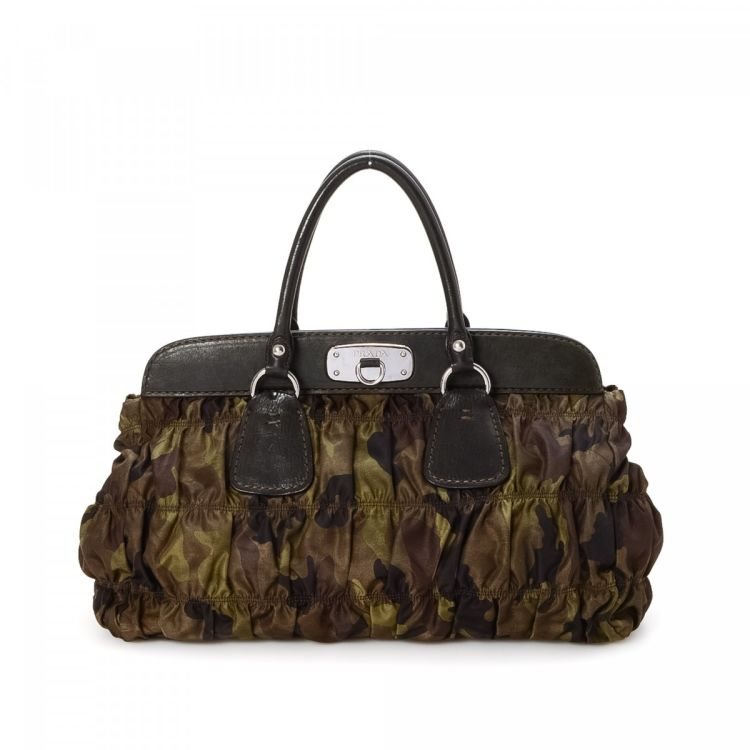 969310b88a61 The authenticity of this vintage Prada Camouflage Shoulder Bag handbag is  guaranteed by LXRandCo. This signature bag was crafted in tessuto nylon in  multi ...