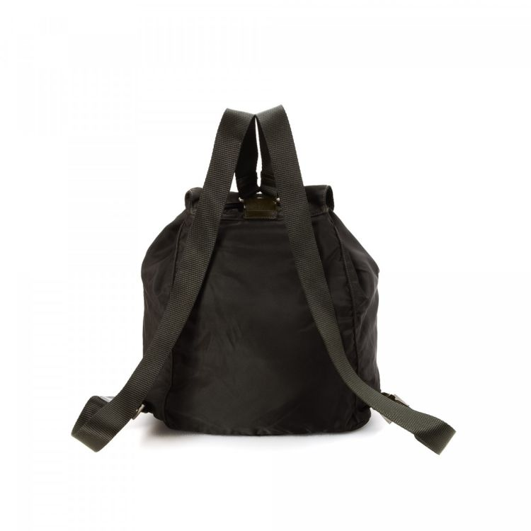 fce5899f2537 LXRandCo guarantees this is an authentic vintage Prada Vela backpack. This  sophisticated knapsack was crafted in tessuto nylon in black.
