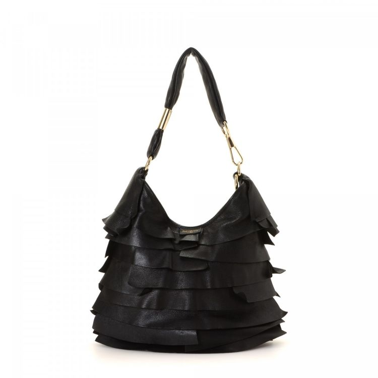 a5a80ce6991 LXRandCo guarantees this is an authentic vintage Yves Saint Laurent St.  Tropez Ruffle Hobo Bag handbag. This classic bag in black is made of  leather.