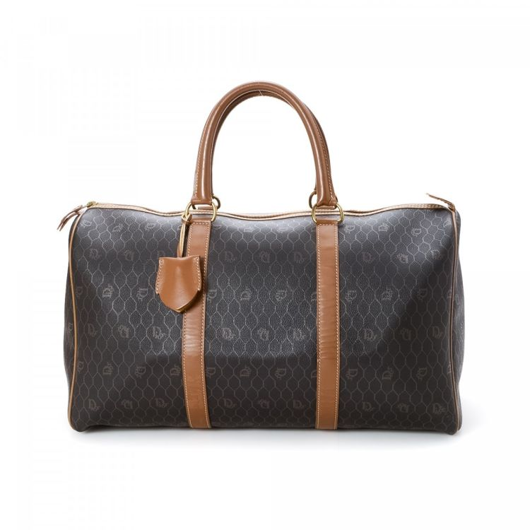 LXRandCo guarantees the authenticity of this vintage Dior Duffel Bag travel  bag. This chic satchel was crafted in monogram coated canvas in beautiful  brown. 5aca12c1e54c5