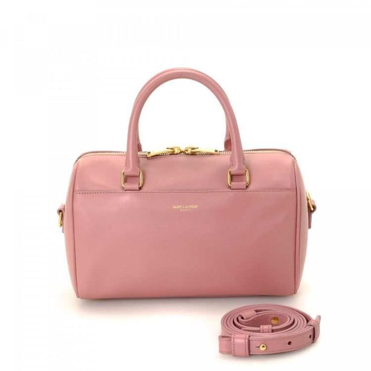 The authenticity of this vintage Yves Saint Laurent Classic Duffle 3 Bag  handbag is guaranteed by LXRandCo. This classic bag comes in baby pink  leather. 20c4ab3ac1c6a