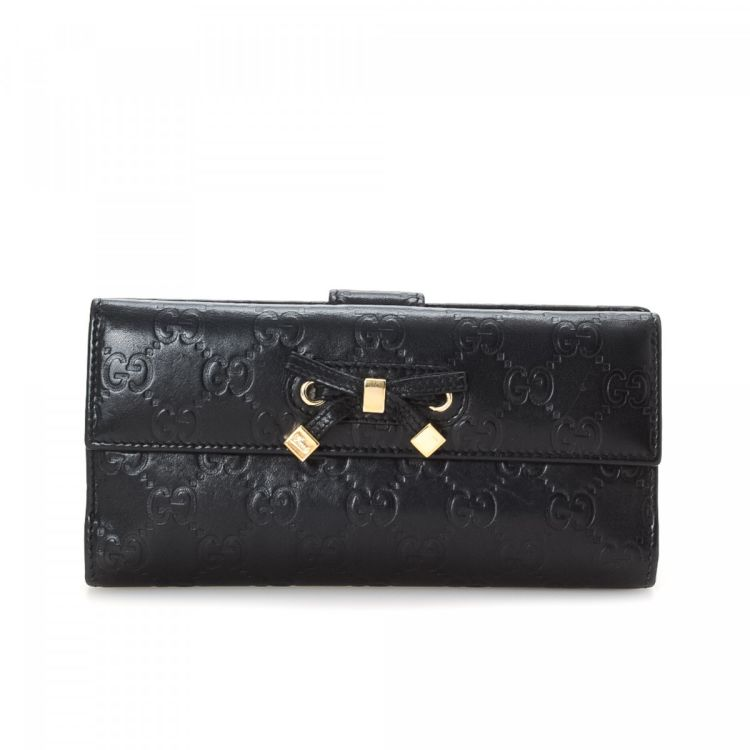 2a02b9bf3f4 LXRandCo guarantees this is an authentic vintage Gucci Princy Continental  wallet. This practical compact wallet in black is made in guccissima  leather.