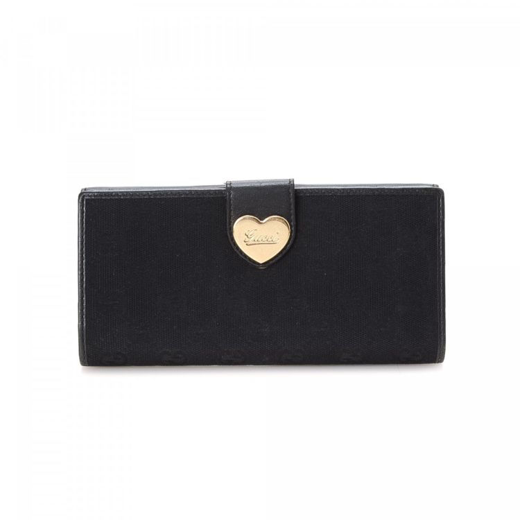 cb0df303ef9f The authenticity of this vintage Gucci wallet is guaranteed by LXRandCo.  This signature card holder was crafted in canvas in black.
