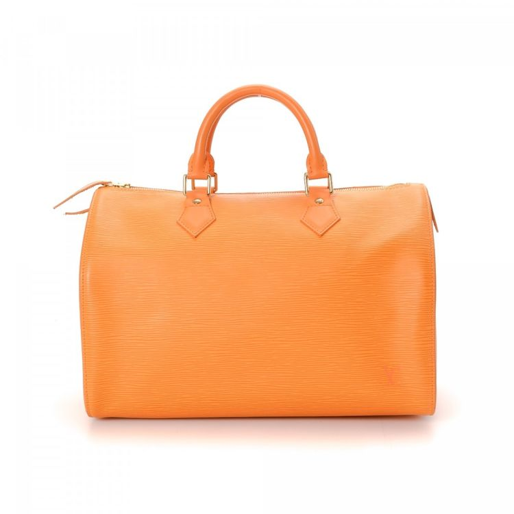 194f1b95b4f1a LXRandCo guarantees this is an authentic vintage Louis Vuitton Speedy 30  handbag. This sophisticated pocketbook was crafted in epi leather in  mandarin.