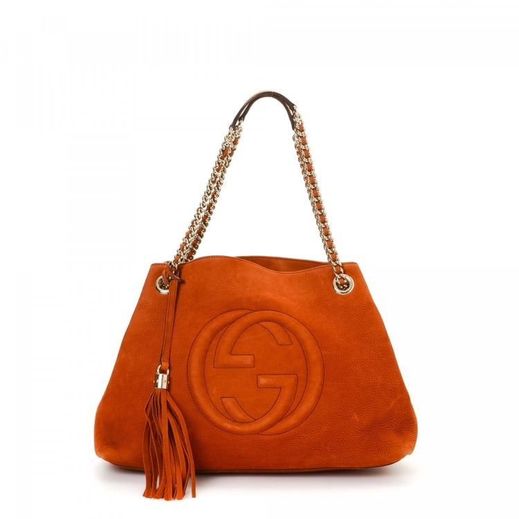 cf4ad85e6 LXRandCo guarantees the authenticity of this vintage Gucci tote. This  classic work bag in orange is made in soho leather. Due to the vintage  nature of this ...