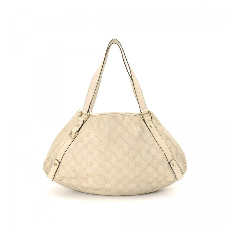 33153078f002 LXRandCo guarantees the authenticity of this vintage Gucci Abbey Medium Tote  shoulder bag. This elegant shoulder bag in white is made in guccissima  leather.