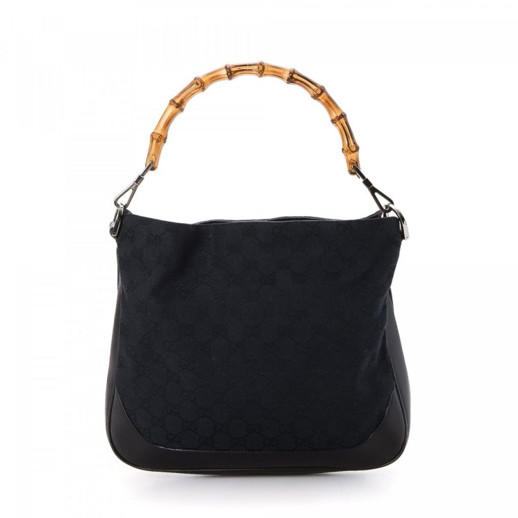 b8c04d2117cc1f The authenticity of this vintage Gucci Bamboo handbag is guaranteed by  LXRandCo. Crafted in gg canvas, this signature bag comes in black.