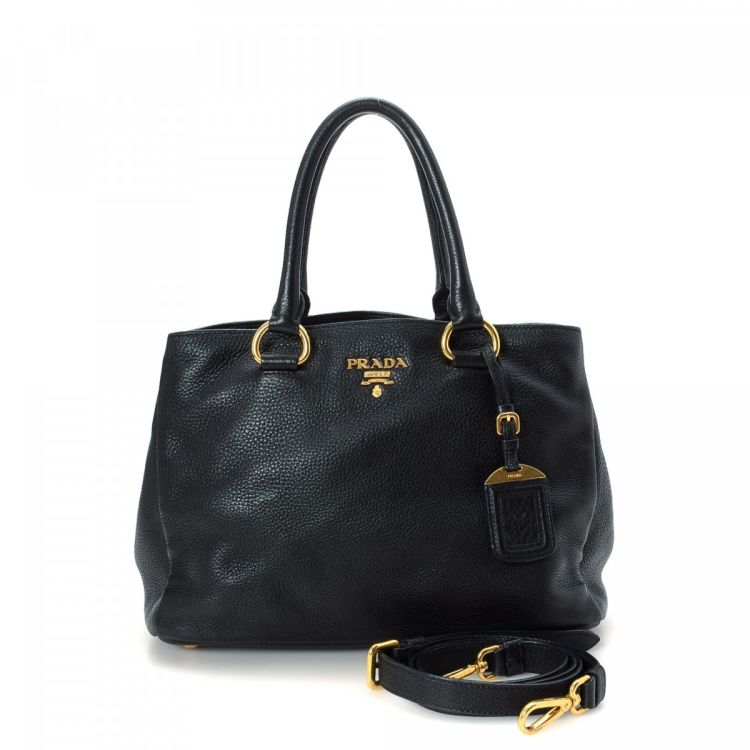 d32089ab0fa6 The authenticity of this vintage Prada Two Way Bag handbag is guaranteed by  LXRandCo. Crafted in saffiano leather, this lovely bag comes in beautiful  black.