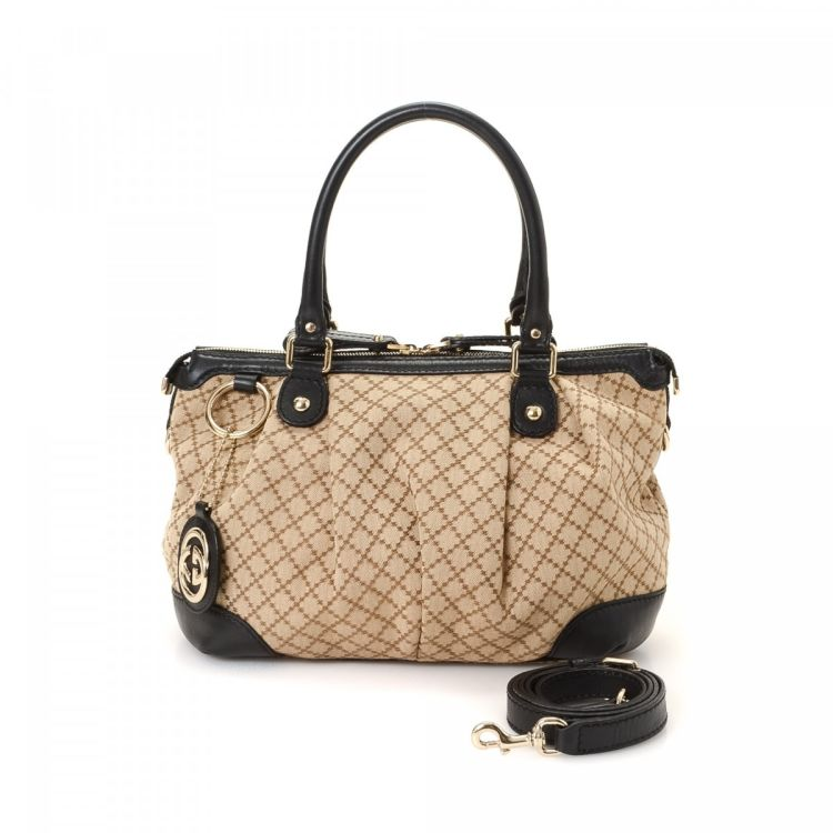 8fa519aa8355d4 LXRandCo guarantees the authenticity of this vintage Gucci Sukey Tote Bag  handbag. This stylish handbag in beige is made in diamante canvas.