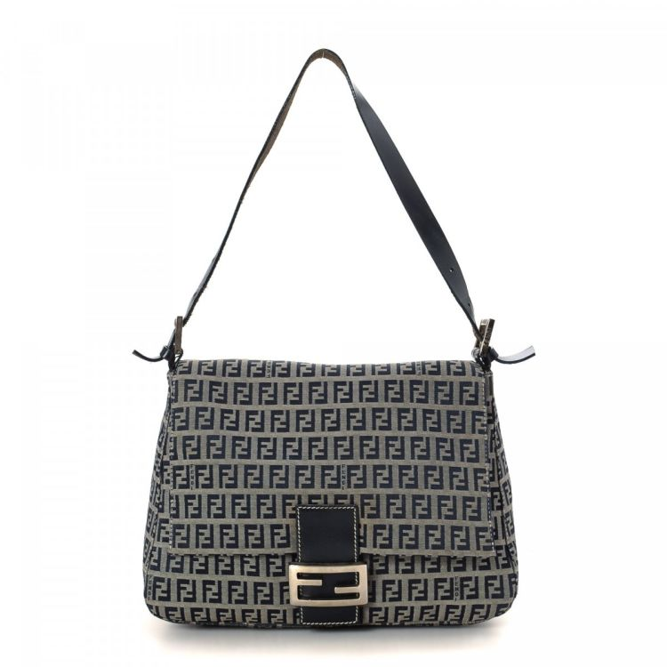 bb2a94309936 LXRandCo guarantees this is an authentic vintage Fendi Mamma Baguette  shoulder bag. This sophisticated pocketbook in black is made in zucchino  canvas.