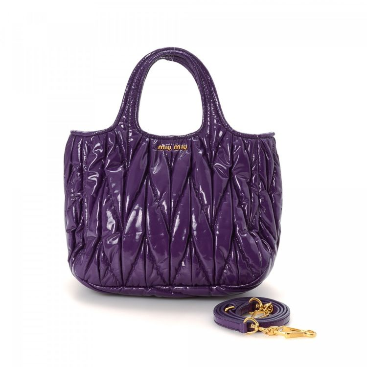 c0c1cd92a5fb The authenticity of this vintage Miu Miu Coffer Two Way Bag handbag is  guaranteed by LXRandCo. This elegant handbag in beautiful purple is made of  patent ...