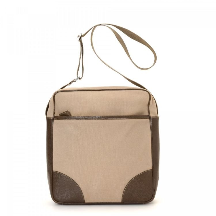 3d7e15c5bc50 The authenticity of this vintage Prada Crossbody Bag messenger   crossbody  bag is guaranteed by LXRandCo. This stylish hobo bag was crafted in canvas  in ...
