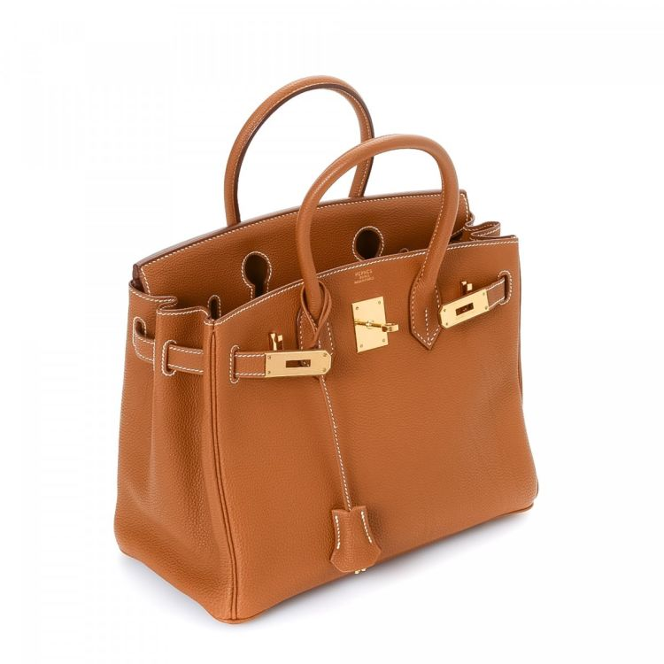 03f3a32e25aa LXRandCo guarantees the authenticity of this vintage Hermès Birkin 30 Gold  Hardware handbag. This iconic pocketbook was crafted in togo calf in gold.