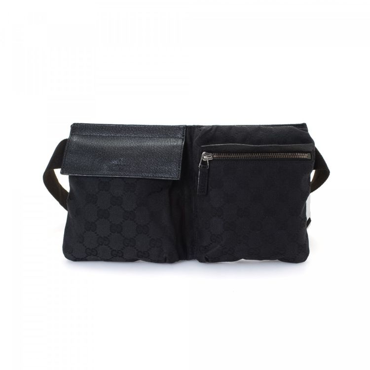 fdc0dd9e29a286 LXRandCo guarantees the authenticity of this vintage Gucci Waist Pouch  vanity case & pouch. This practical pouch in beautiful black is made in gg  canvas.