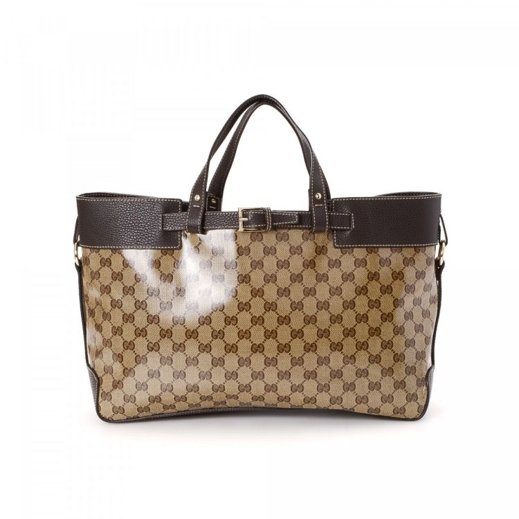 85828cecfe78 The authenticity of this vintage Gucci Crystal tote is guaranteed by  LXRandCo. This beautiful bag was crafted in gg coated canvas in beige.