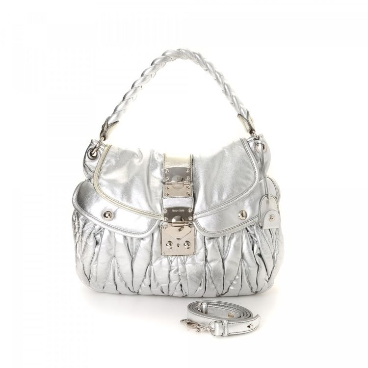 caee54354dd9 LXRandCo guarantees this is an authentic vintage Miu Miu Two Way Bag handbag.  This iconic bag was crafted in matelasse leather in beautiful silver.
