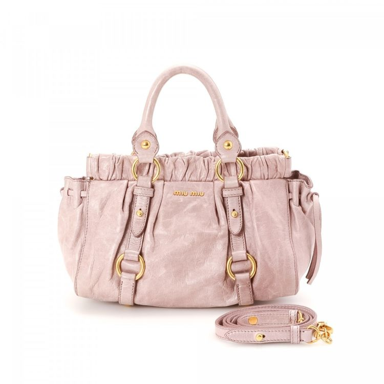 The authenticity of this vintage Miu Miu Gathered Two Way Bag handbag is  guaranteed by LXRandCo. This practical handbag in beautiful light pink is  made of ... bc64f5f0d1efd