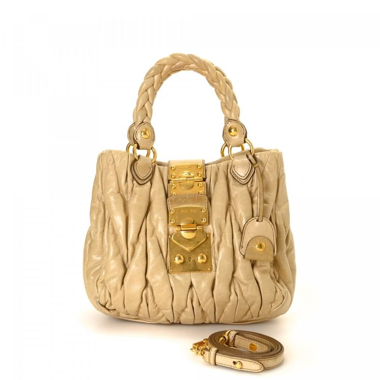 The authenticity of this vintage Miu Miu Coffer Two Way Bag handbag is  guaranteed by LXRandCo. This chic bag in gold tone is made in matelassé  leather. 258bafb083922