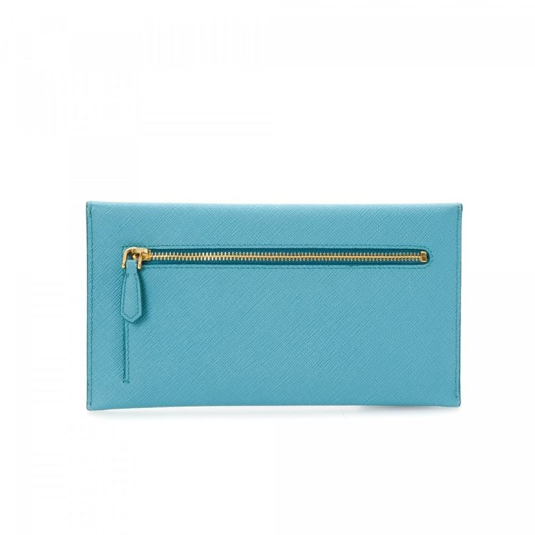 abd9199e47704d LXRandCo guarantees the authenticity of this vintage Prada Envelope wallet.  This classic card holder was crafted in saffiano leather in blue.
