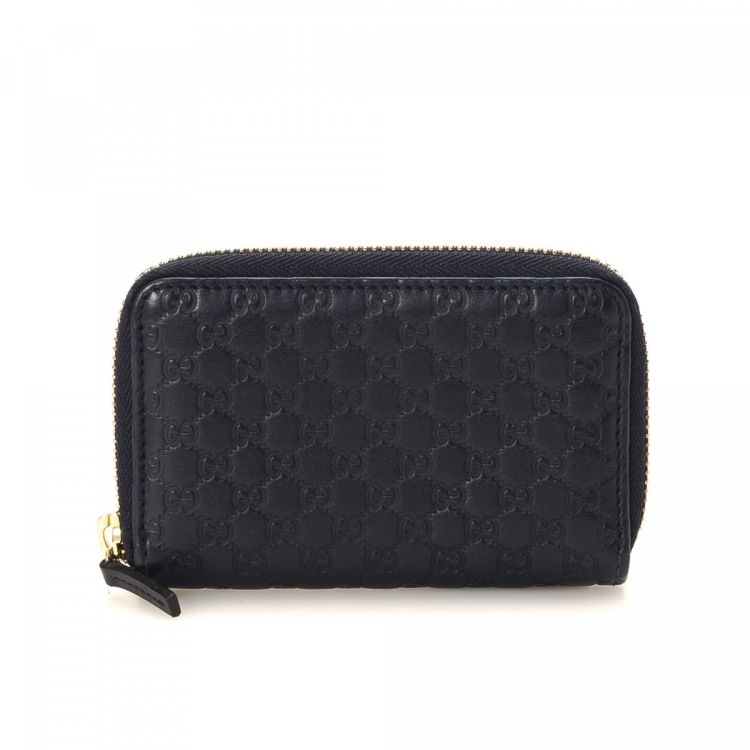 4e8b4349aefb LXRandCo guarantees this is an authentic vintage Gucci Zip Around Coin  Purse wallet. This elegant slimfold in black is made in microguccissima  leather.