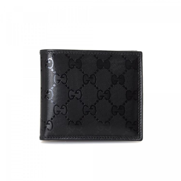 4eb2fdf1be3 ... the authenticity of this vintage Gucci Two Fold wallet. Crafted in gg  imprime coated canvas, this exquisite card holder comes in beautiful black.