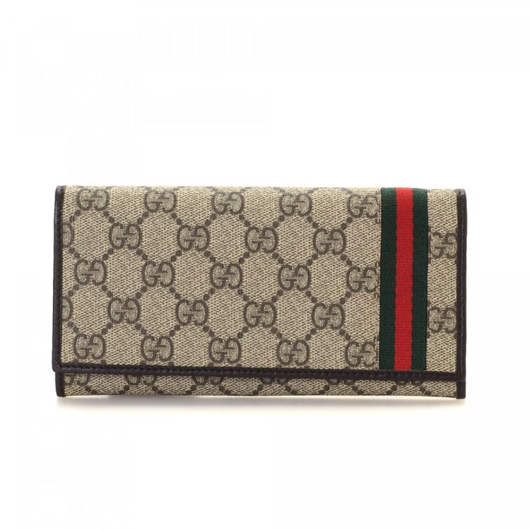 0b2a559384762d LXRandCo guarantees the authenticity of this vintage Gucci Web wallet. This  sophisticated bifold in beautiful beige is made in gg supreme coated canvas.