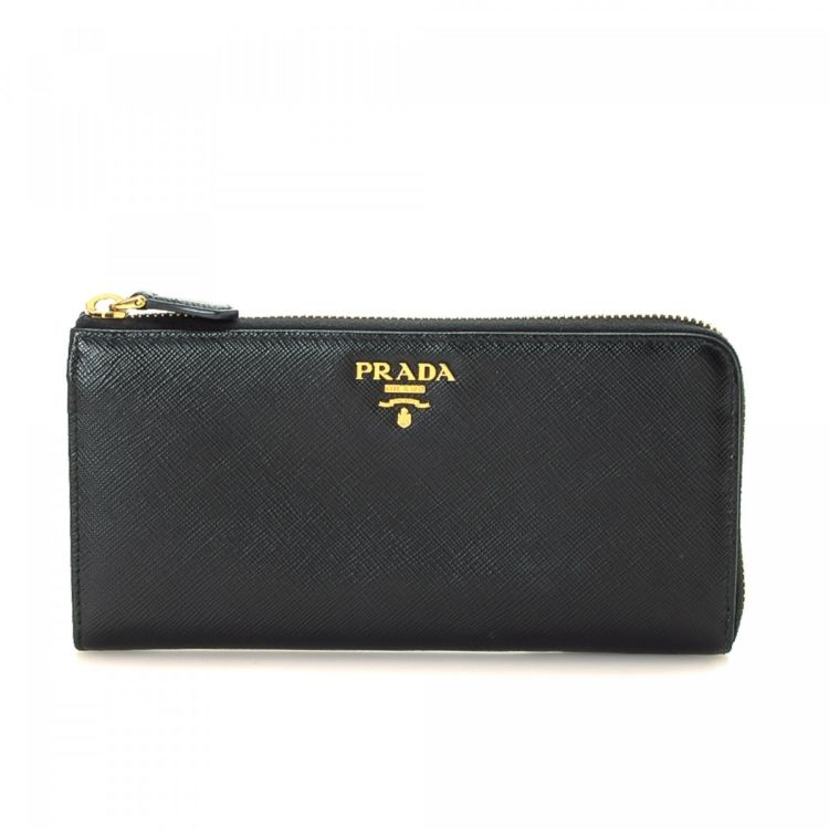 2dcdb3ba43a8 The authenticity of this vintage Prada Long wallet is guaranteed by LXRandCo.  This classic coin purse was crafted in saffiano leather in black.