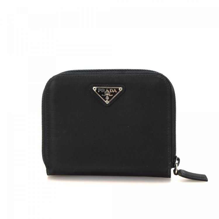 b14996b7088d LXRandCo guarantees this is an authentic vintage Prada Compact wallet.  Crafted in tessuto nylon