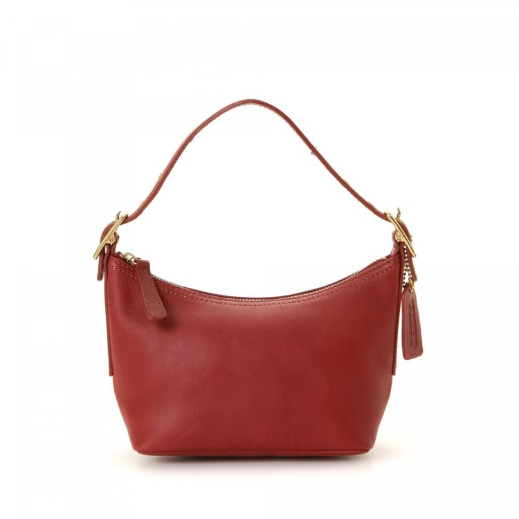 3424f34bbe LXRandCo guarantees the authenticity of this vintage Coach handbag. Crafted  in leather, this luxurious purse comes in red. Due to the vintage nature of  this ...