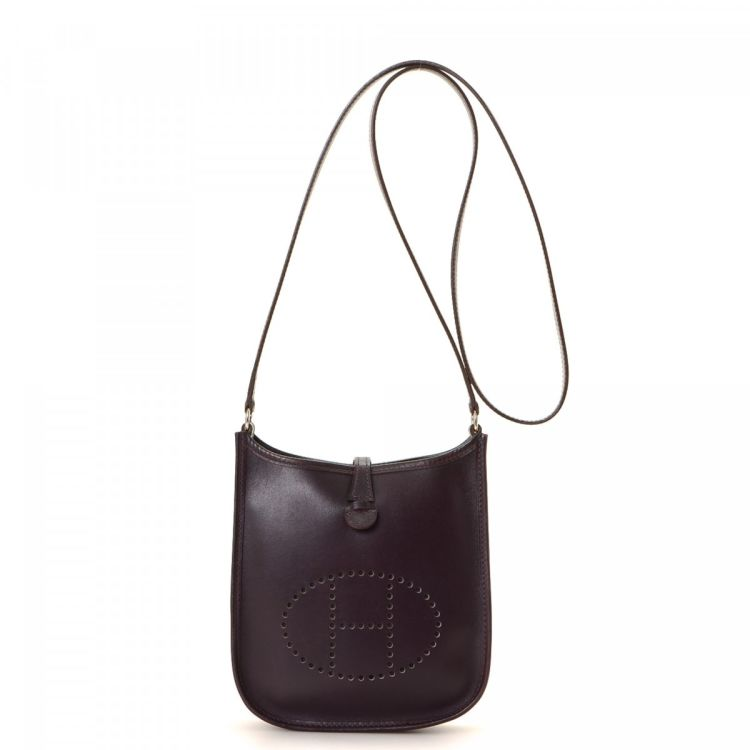 fcc1e14e053f LXRandCo guarantees the authenticity of this vintage Hermès Evelyne TPM  Raisin Box Calf PHW crossbody bag. This beautiful bag in raisin is made of  box calf ...