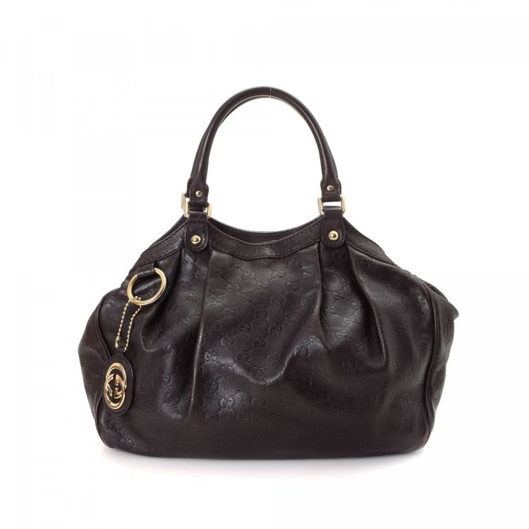 9026a141a1e01f LXRandCo guarantees this is an authentic vintage Gucci Sukey Tote shoulder  bag. This elegant shoulder bag in brown is made in guccissima leather.