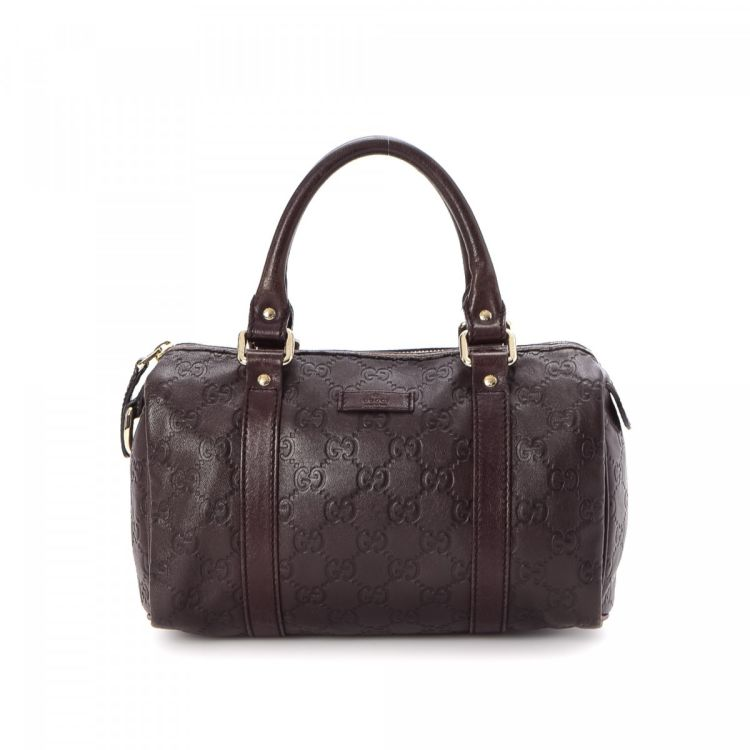 4376810e5 The authenticity of this vintage Gucci Joy Boston Bag travel bag is  guaranteed by LXRandCo. This signature carry on in beautiful brown is made  in guccissima ...