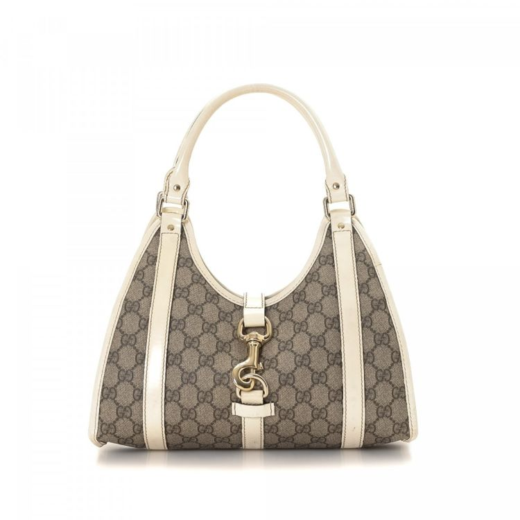 f0470d76585 The authenticity of this vintage Gucci Bardot shoulder bag is guaranteed by  LXRandCo. This stylish pocketbook in grey is made in gg supreme coated  canvas.