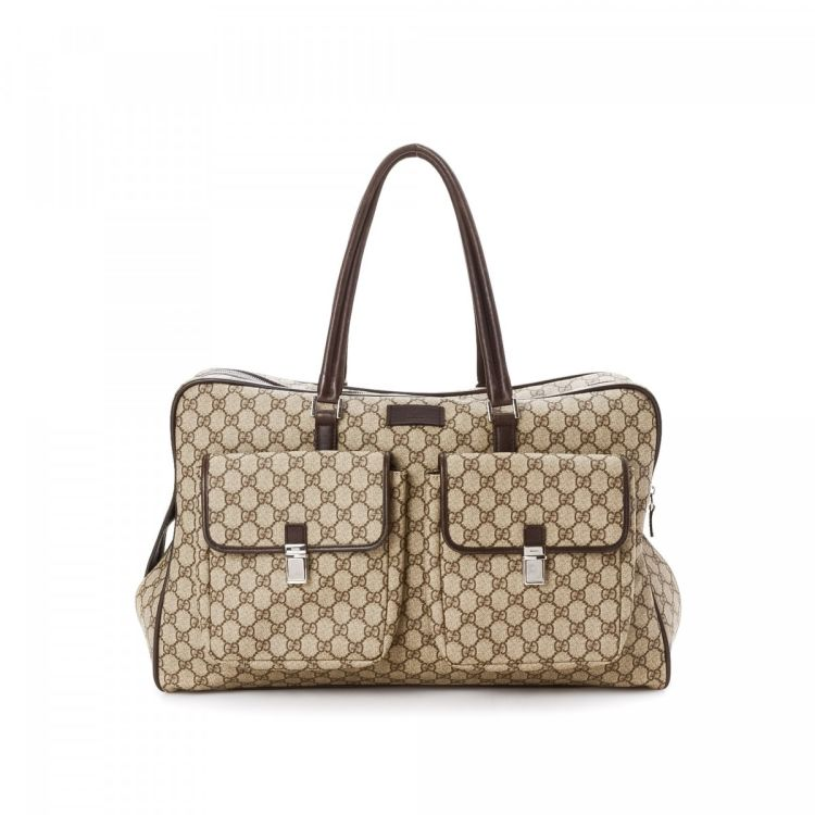 9e638844f96a The authenticity of this vintage Gucci travel bag is guaranteed by LXRandCo.  This stylish garment bag was crafted in gg canvas in beautiful beige.