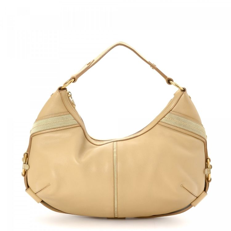 c646651cd4 LXRandCo guarantees this is an authentic vintage Yves Saint Laurent Hobo  Bag shoulder bag. Crafted in leather