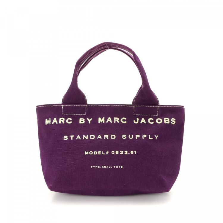 0c13538d94ec LXRandCo guarantees this is an authentic vintage Marc by Marc Jacobs  Standard Supply tote. This luxurious large handbag in purple is made of  canvas.