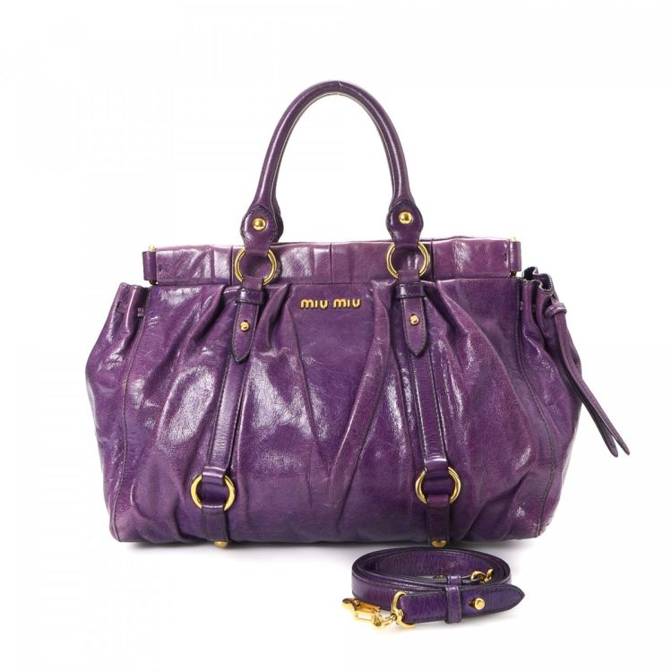 The authenticity of this vintage Miu Miu Two Way Bag handbag is guaranteed  by LXRandCo. This stylish purse was crafted in leather in purple. 2d2f5cfdf79ad