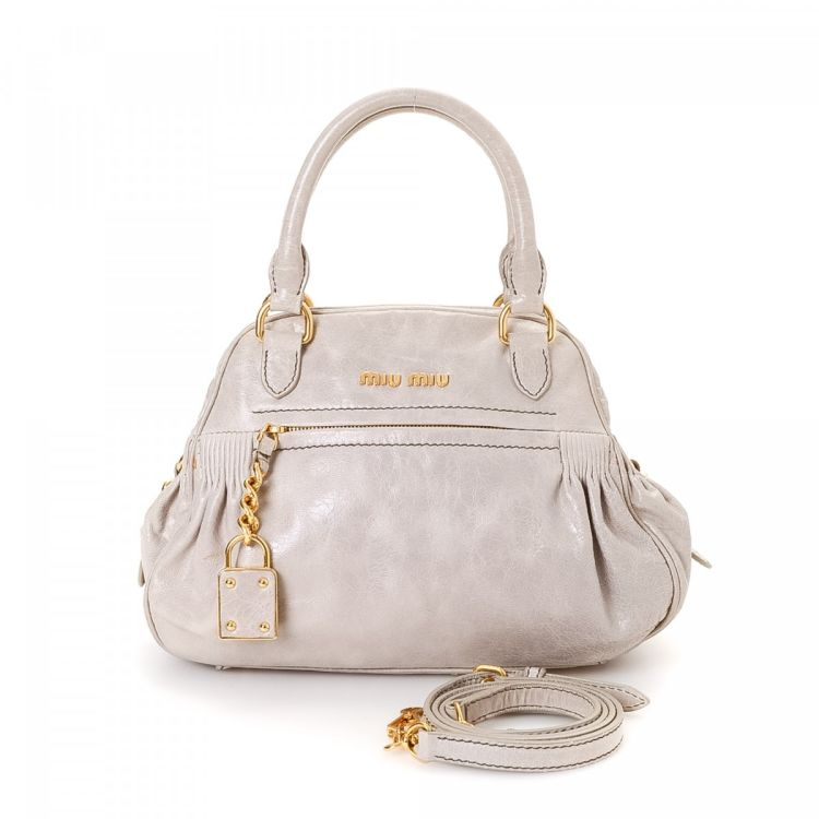 1ad3d56bfe6 LXRandCo guarantees this is an authentic vintage Miu Miu Nappa Charm Two  Way Bag shoulder bag. This elegant shoulder bag was crafted in leather in  beautiful ...