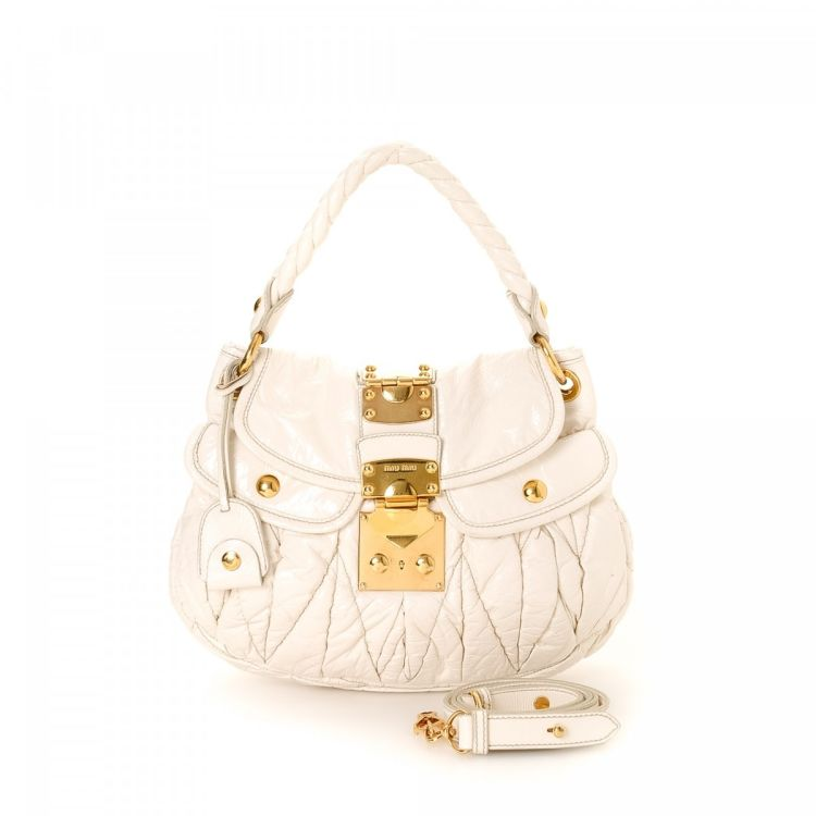 LXRandCo guarantees this is an authentic vintage Miu Miu Coffer Two Way Bag  shoulder bag. This refined purse was crafted in matelasse leather in  beautiful ... 27d0538c4156c