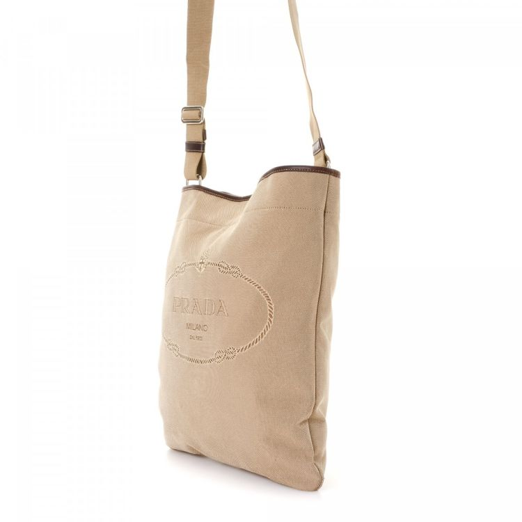 72d0139cbd LXRandCo guarantees this is an authentic vintage Prada Logo Crossbody Bag  messenger   crossbody bag. Crafted in jacquard canvas