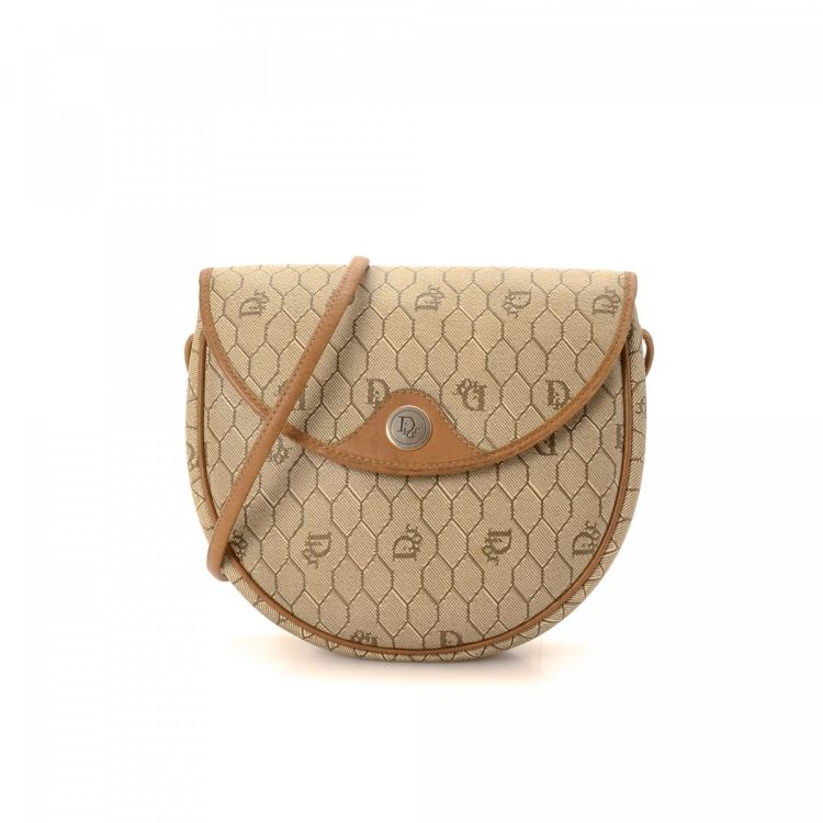 0255dae8f90f LXRandCo guarantees this is an authentic vintage Dior Crossbody Bag  messenger   crossbody bag. This everyday crossbody in beige is made of  canvas.