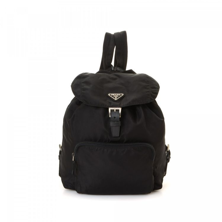 9e580e6a8d92 LXRandCo guarantees this is an authentic vintage Prada Vela backpack. This  signature book bag in black is made in tessuto nylon. Due to the vintage  nature ...
