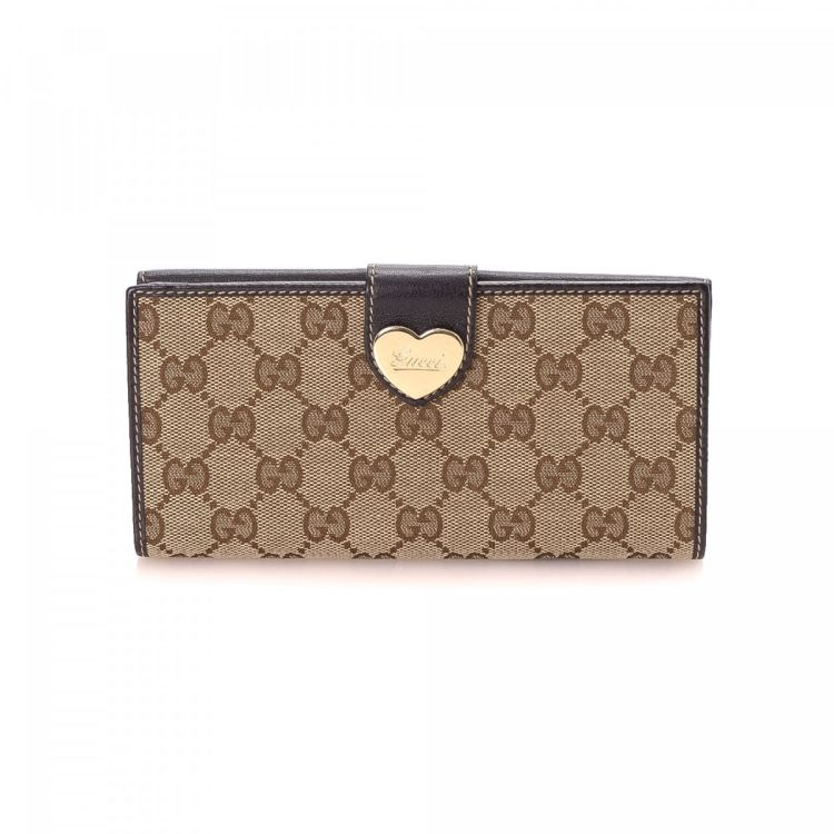 9742b1889184 LXRandCo guarantees this is an authentic vintage Gucci Heart Continental  wallet. Crafted in gg canvas, this classic wallet comes in brown.