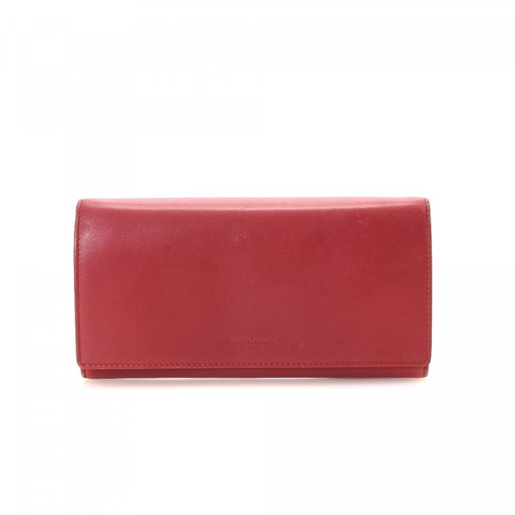 43af0107cb3 The authenticity of this vintage Yves Saint Laurent Long wallet is  guaranteed by LXRandCo. This classic card case was crafted in leather in red .